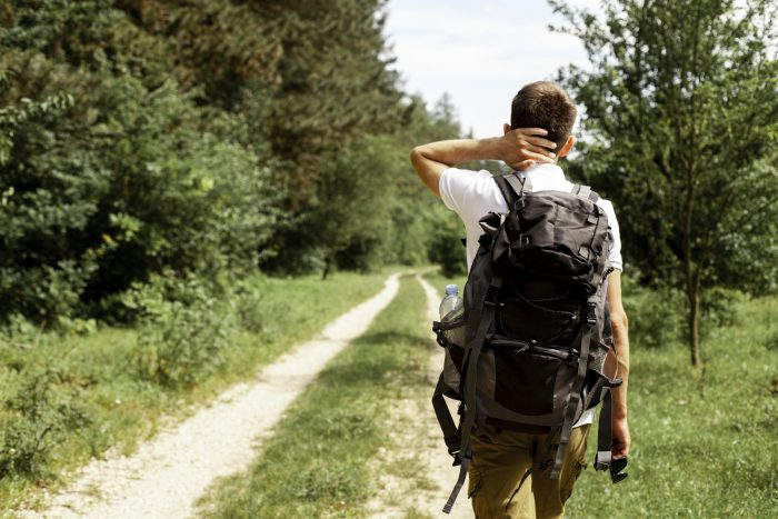 Young man traveling and exploring nature